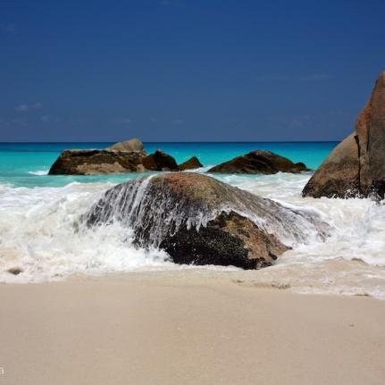 waves breaking over rocks