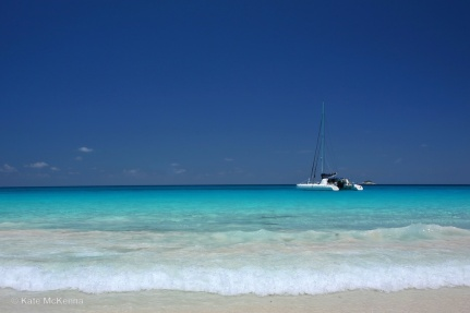 blue sea and distant catamaran