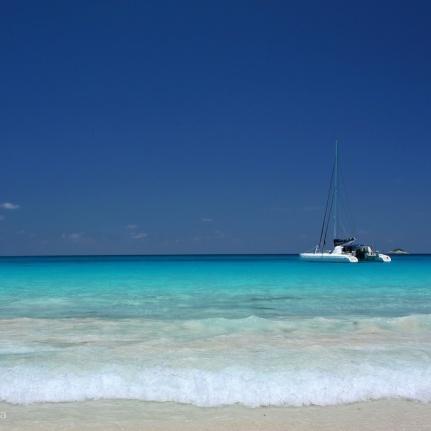 blue sea and distant catamaran