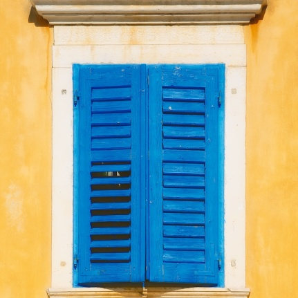 photo blue shuttered window